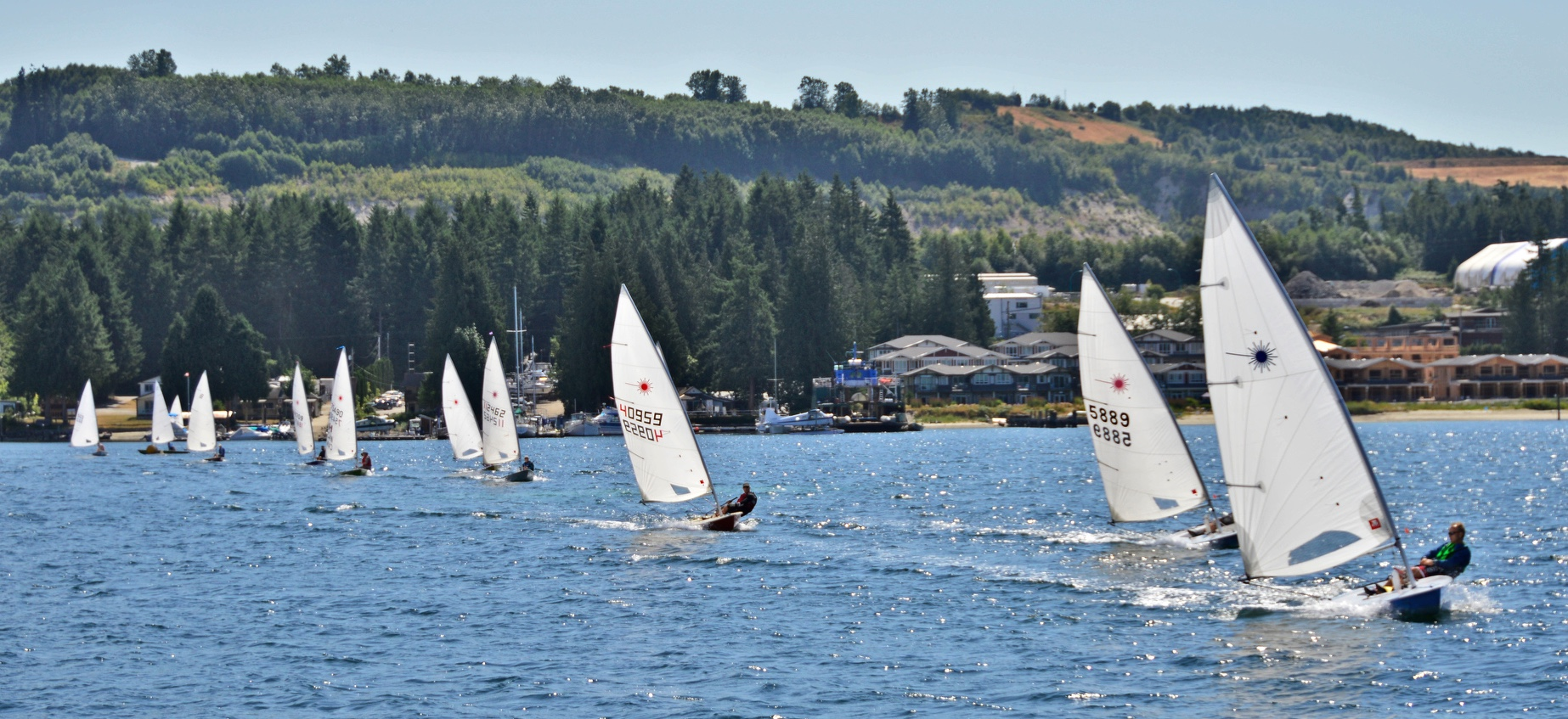 Sailors lead out from the Marina for the start of the 6th Annual Poise Cove Regatta July 16th, 2017