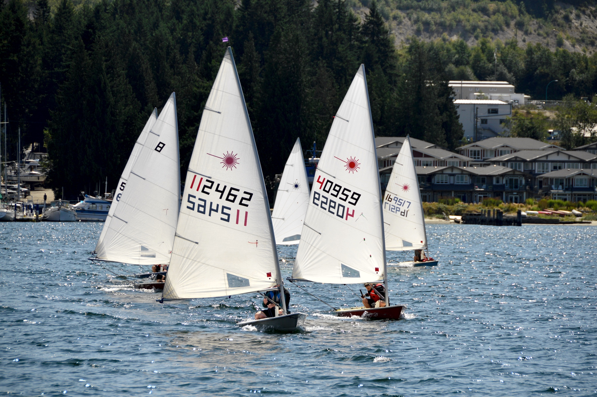 Sailors racing on a beam reach during the 6th Annual Poise Cove Regatta July 16th, 2017