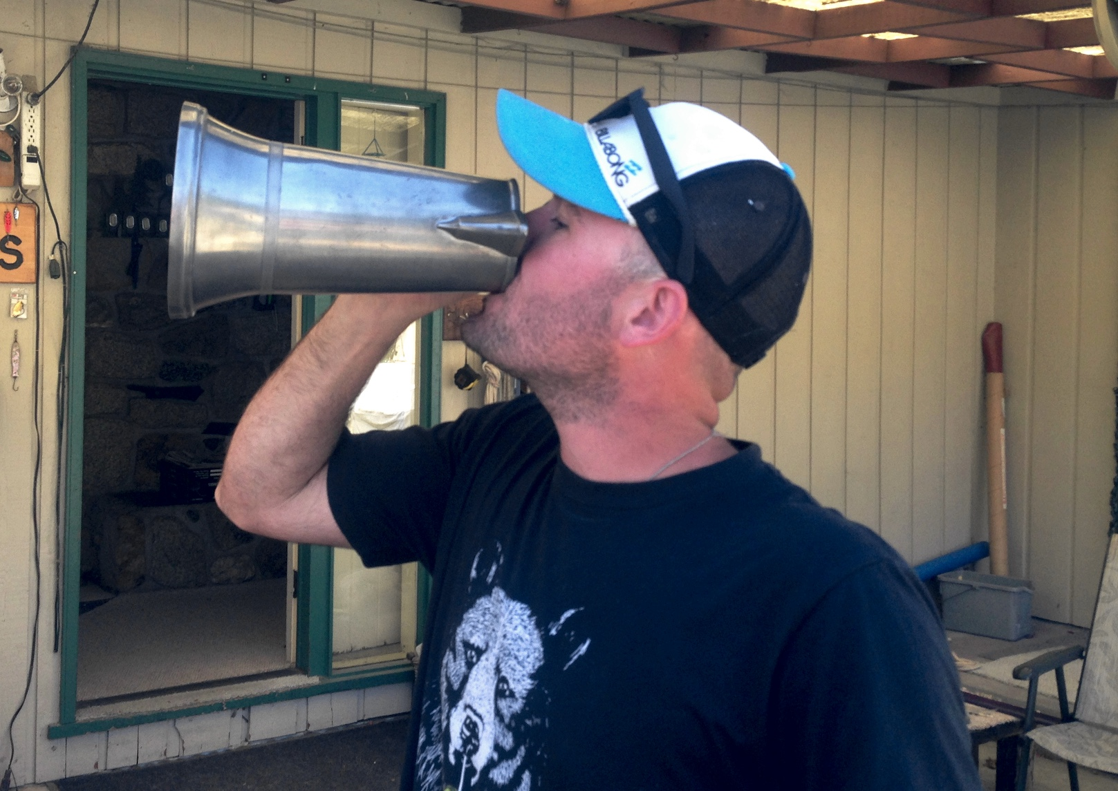 Nick Farrer drinks from the Tankard after winning the 2018 Poise Cove Classic.