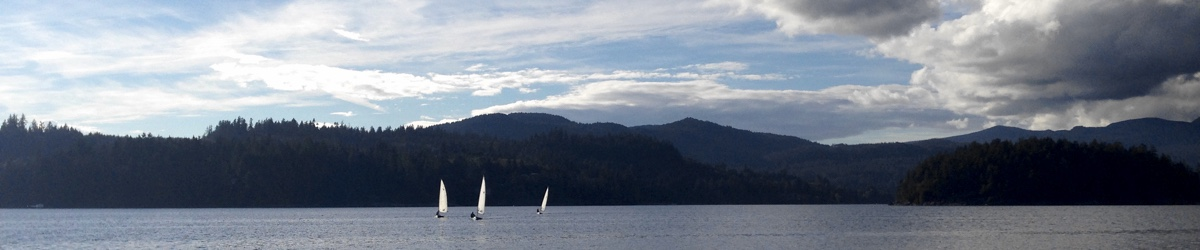 Three boats head back home after late September sailing on Porpoise Bay.
