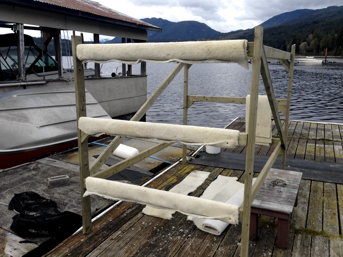 The third rack will allow 4 more sailers to launch from the water. The carpet is so the boats slide into and out of the racks easier.