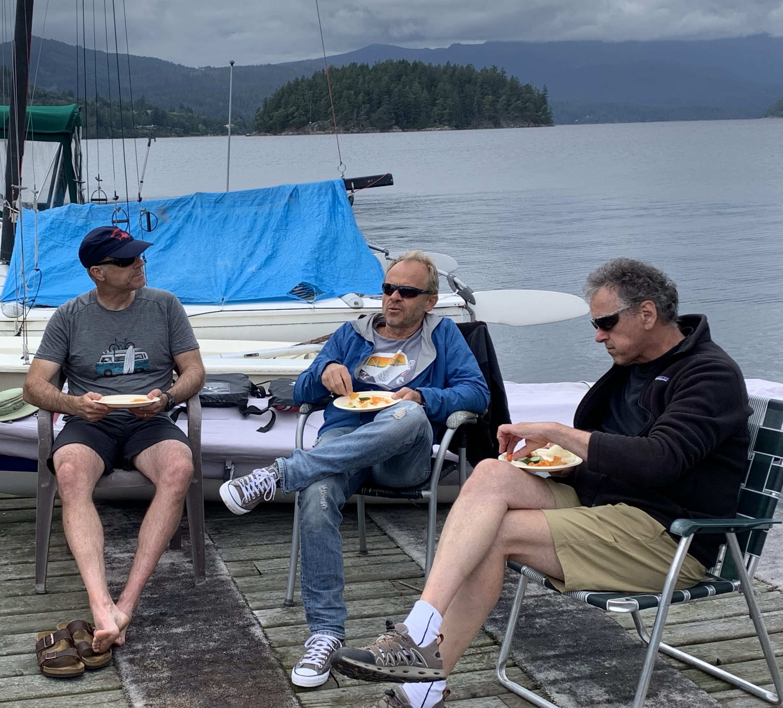 Brian, Grzegorz and Kim enjoy the BBQ and conversation after sailing.