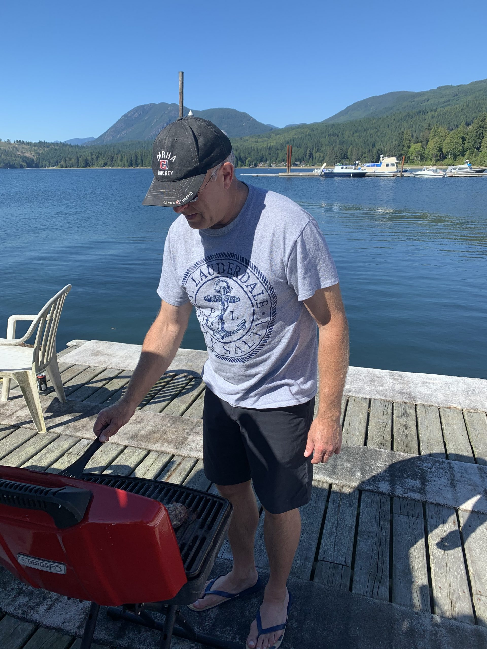 Dennis tends to the grill after an afternoon of racing on Porpoise Bay in Sechelt BC.