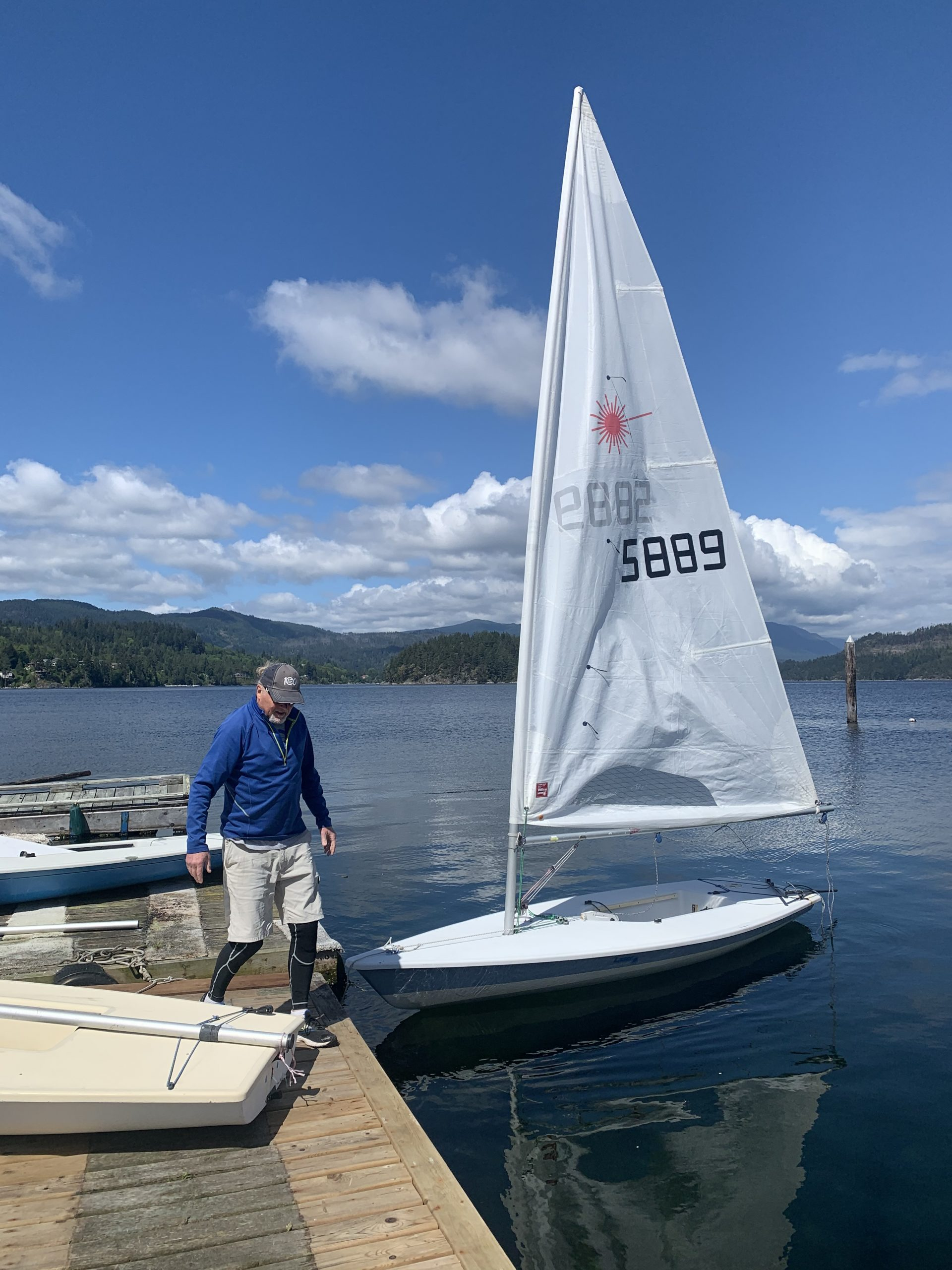 Thomas getting his boat rigged up for an afternoon of sailing